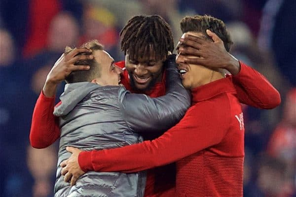 LIVERPOOL, ENGLAND - Sunday, December 2, 2018: Liverpool's match winning goal-scorer Divock Origi (C) celebrates with Xherdan Shaqiri (L) and Roberto Firmino (R) after a dramatic late injury time goal during the FA Premier League match between Liverpool FC and Everton FC at Anfield, the 232nd Merseyside Derby. Liverpool won 1-0. (Pic by Paul Greenwood/Propaganda)
