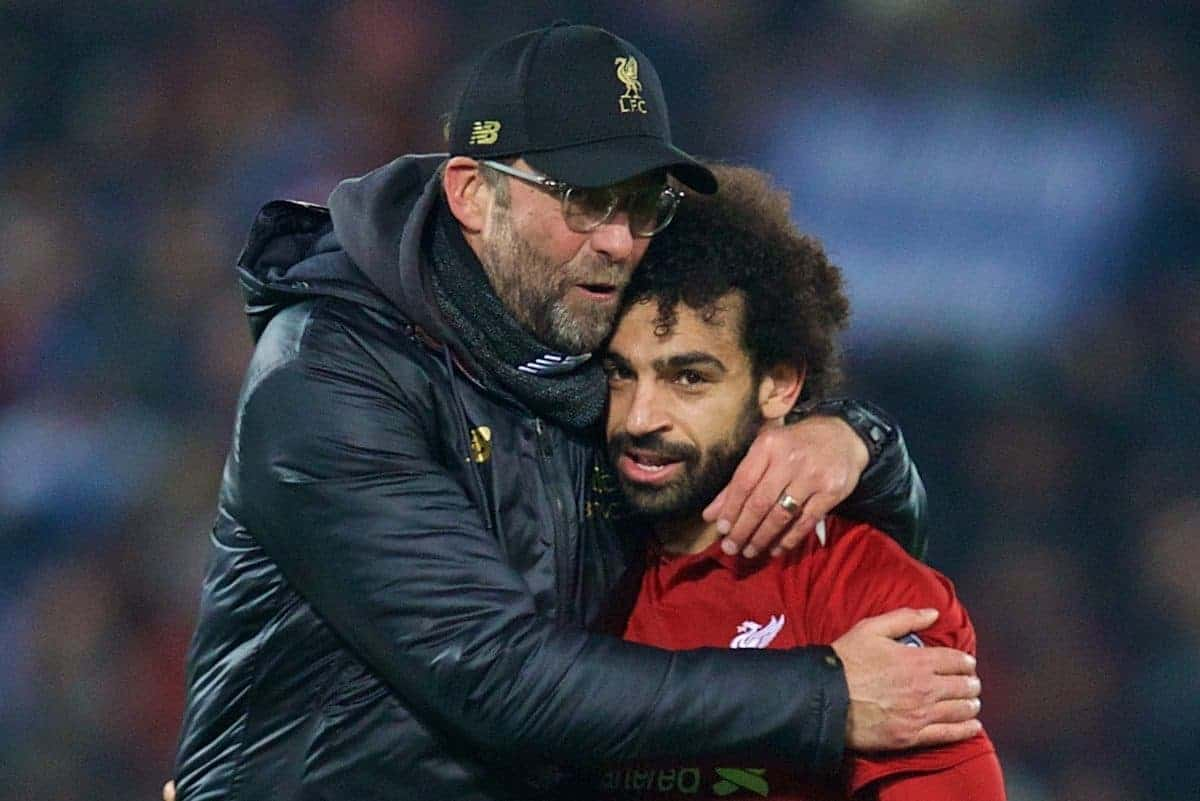 LIVERPOOL, ENGLAND - Tuesday, December 11, 2018: Liverpool's manager J¸rgen Klopp celebrates with goal-scorer Mohamed Salah after beating SSC Napoli 1-0 and progressing to the knock-out phase during the UEFA Champions League Group C match between Liverpool FC and SSC Napoli at Anfield. (Pic by David Rawcliffe/Propaganda)