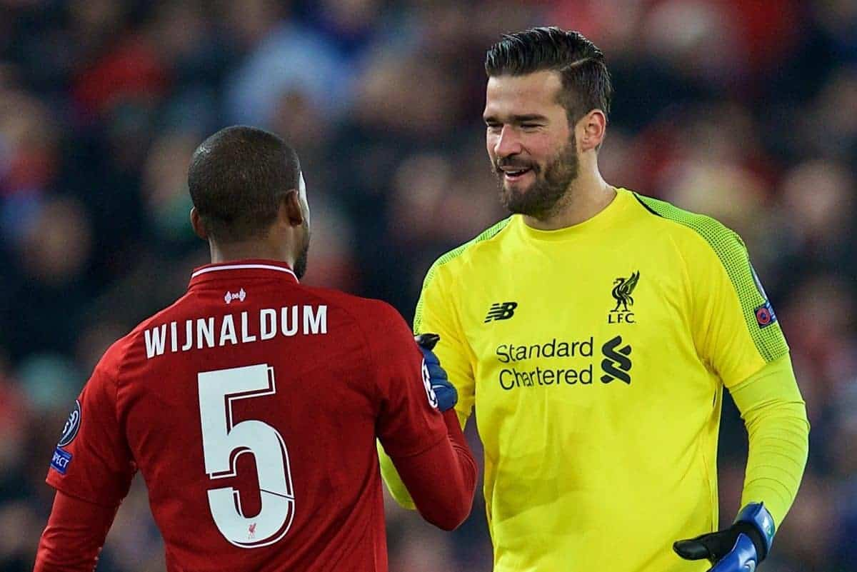 LIVERPOOL, ENGLAND - Tuesday, December 11, 2018: Liverpool's goalkeeper Alisson Becker celebrates with Georginio Wijnaldum after beating SSC Napoli 1-0 and progressing to the knock-out phase during the UEFA Champions League Group C match between Liverpool FC and SSC Napoli at Anfield. (Pic by David Rawcliffe/Propaganda)