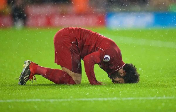 WOLVERHAMPTON, ENGLAND - Friday, December 21, 2018: Liverpool's Mohamed Salah kneels to pray as he celebrates scoring the first goal during the FA Premier League match between Wolverhampton Wanderers FC and Liverpool FC at Molineux Stadium. (Pic by David Rawcliffe/Propaganda)