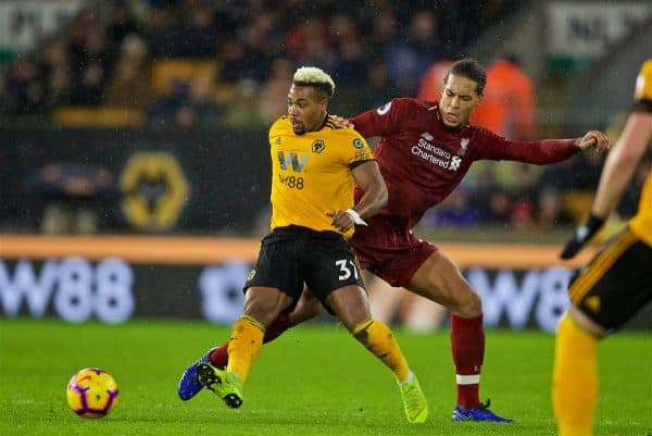 WOLVERHAMPTON, ENGLAND - Friday, December 21, 2018: Wolverhampton Wanderers's Adama Traoré (L) and Liverpool's Virgil van Dijk during the FA Premier League match between Wolverhampton Wanderers FC and Liverpool FC at Molineux Stadium. (Pic by David Rawcliffe/Propaganda)