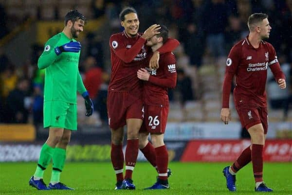 WOLVERHAMPTON, ENGLAND - Friday, December 21, 2018: Liverpool's goal-scorer Virgil van Dijk celebrates with team-mates Andy Robertson after beating Wolverhampton Wanderers 2-0 during the FA Premier League match between Wolverhampton Wanderers FC and Liverpool FC at Molineux Stadium. (Pic by David Rawcliffe/Propaganda)