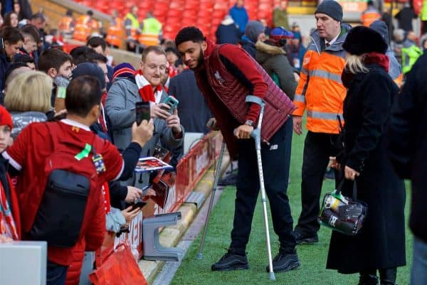 LIVERPOOL, ENGLAND - Boxing Day, Wednesday, December 26, 2018: Liverpool's injured Joe Gomez on crutches stops for photographs with supporters before the FA Premier League match between Liverpool FC and Newcastle United FC at Anfield. (Pic by David Rawcliffe/Propaganda)
