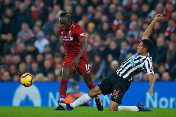 LIVERPOOL, ENGLAND - Boxing Day, Wednesday, December 26, 2018: Liverpool's Sadio Mane is tackled by Newcastle United's Isaac Hayden during the FA Premier League match between Liverpool FC and Newcastle United FC at Anfield. (Pic by David Rawcliffe/Propaganda)