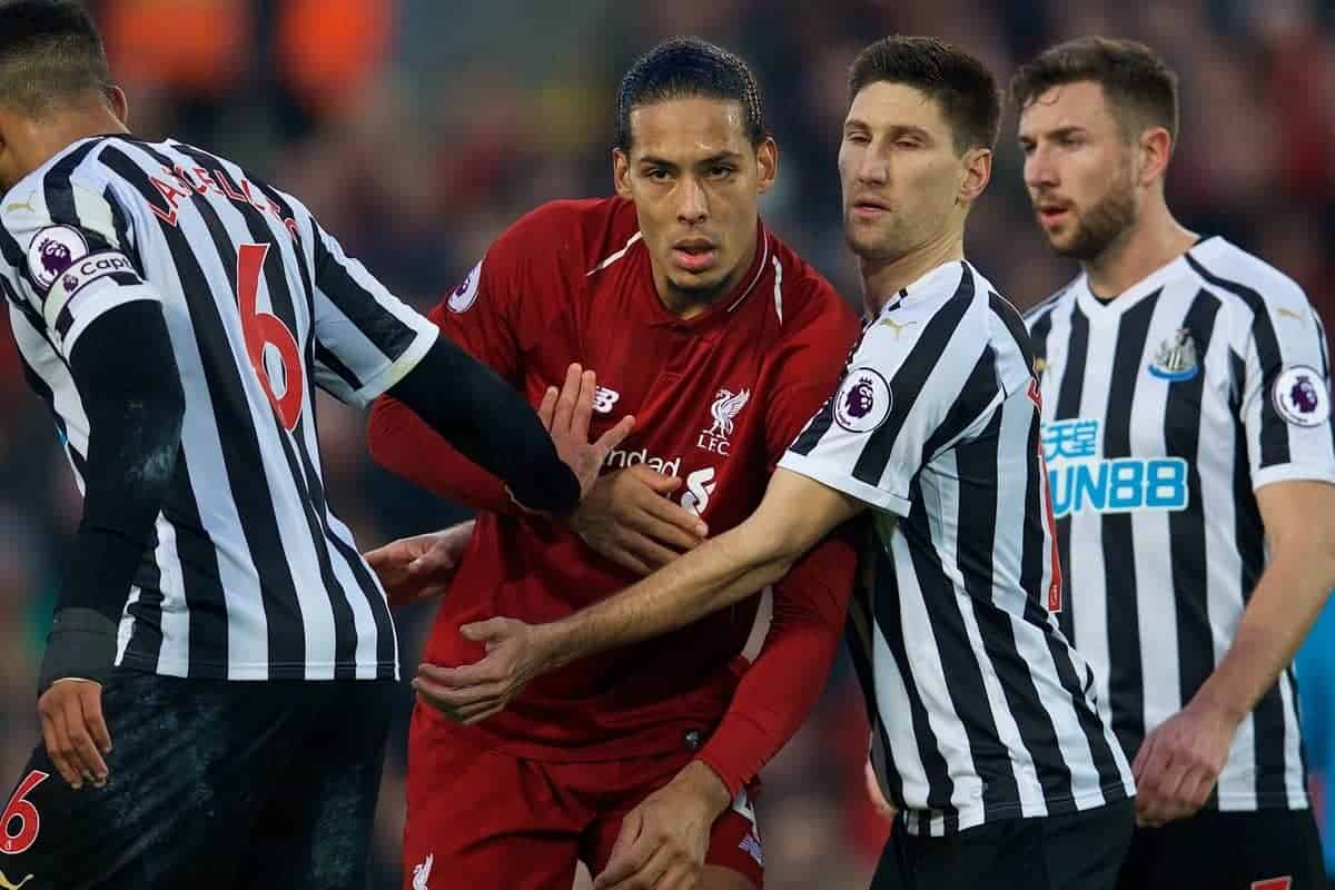 LIVERPOOL, ENGLAND - Boxing Day, Wednesday, December 26, 2018: Liverpool's Virgil van Dijk is held by Newcastle United's captain Jamaal Lascelles (L) and Federico Fernández during the FA Premier League match between Liverpool FC and Newcastle United FC at Anfield. (Pic by David Rawcliffe/Propaganda)