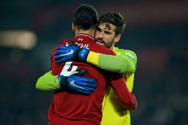 LIVERPOOL, ENGLAND - Boxing Day, Wednesday, December 26, 2018: Liverpool's goalkeeper Alisson Becker celebrates with Virgil van Dijk after beating Newcastle United 4-0 during the FA Premier League match between Liverpool FC and Newcastle United FC at Anfield. (Pic by David Rawcliffe/Propaganda)