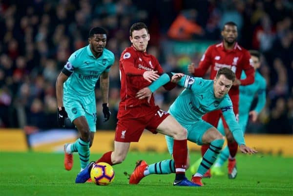 LIVERPOOL, ENGLAND - Saturday, December 29, 2018: Liverpool's Andy Robertson (C), Arsenal's Ainsley Maitland-Niles (L) and Aaron Ramsey (R) during the FA Premier League match between Liverpool FC and Arsenal FC at Anfield. (Pic by David Rawcliffe/Propaganda)