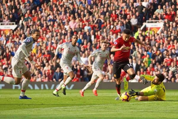 MANCHESTER, ENGLAND - Sunday, February 24, 2019: Liverpool's goalkeeper Alisson Becker makes a save from Manchester United's Jesse Lingard during the FA Premier League match between Manchester United FC and Liverpool FC at Old Trafford. (Pic by David Rawcliffe/Propaganda)