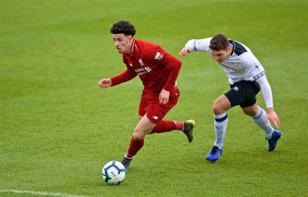 DERBY, ENGLAND - Friday, March 8, 2019: Liverpool's Curtis Jones gets away from Derby County's Ethan Wassall to score the opening goal during the FA Premier League 2 Division 1 match between Derby County FC Under-23's and Liverpool FC Under-23's at the Derby County FC Training Centre. (Pic by David Rawcliffe/Propaganda)