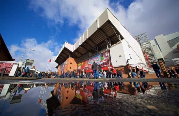 LIVERPOOL, ENGLAND - Saturday, March 9, 2019: An exterior view of Liverpool's Spion Kop stand with supporters reflected in a puddle ahead the FA Premier League match between Liverpool FC and Burnley FC at Anfield. (Pic by David Rawcliffe/Propaganda)