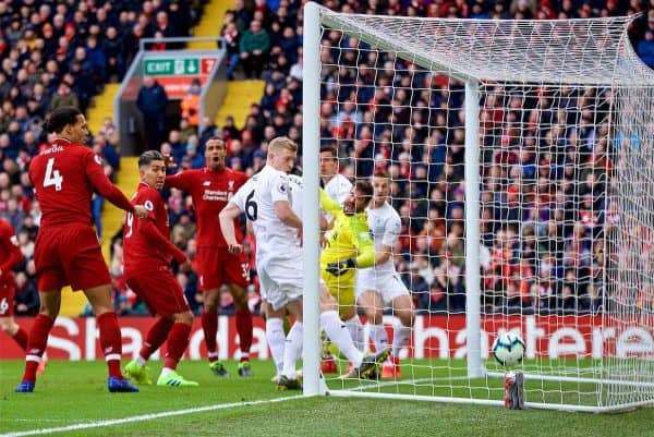 LIVERPOOL, ENGLAND - Saturday, March 9, 2019: Liverpool's goalkeeper Alisson Becker is fauled by two Burnley's players Ben Mee and James Tarkowski as the ball goes in for the opening goal during the FA Premier League match between Liverpool FC and Burnley FC at Anfield. (Pic by David Rawcliffe/Propaganda)