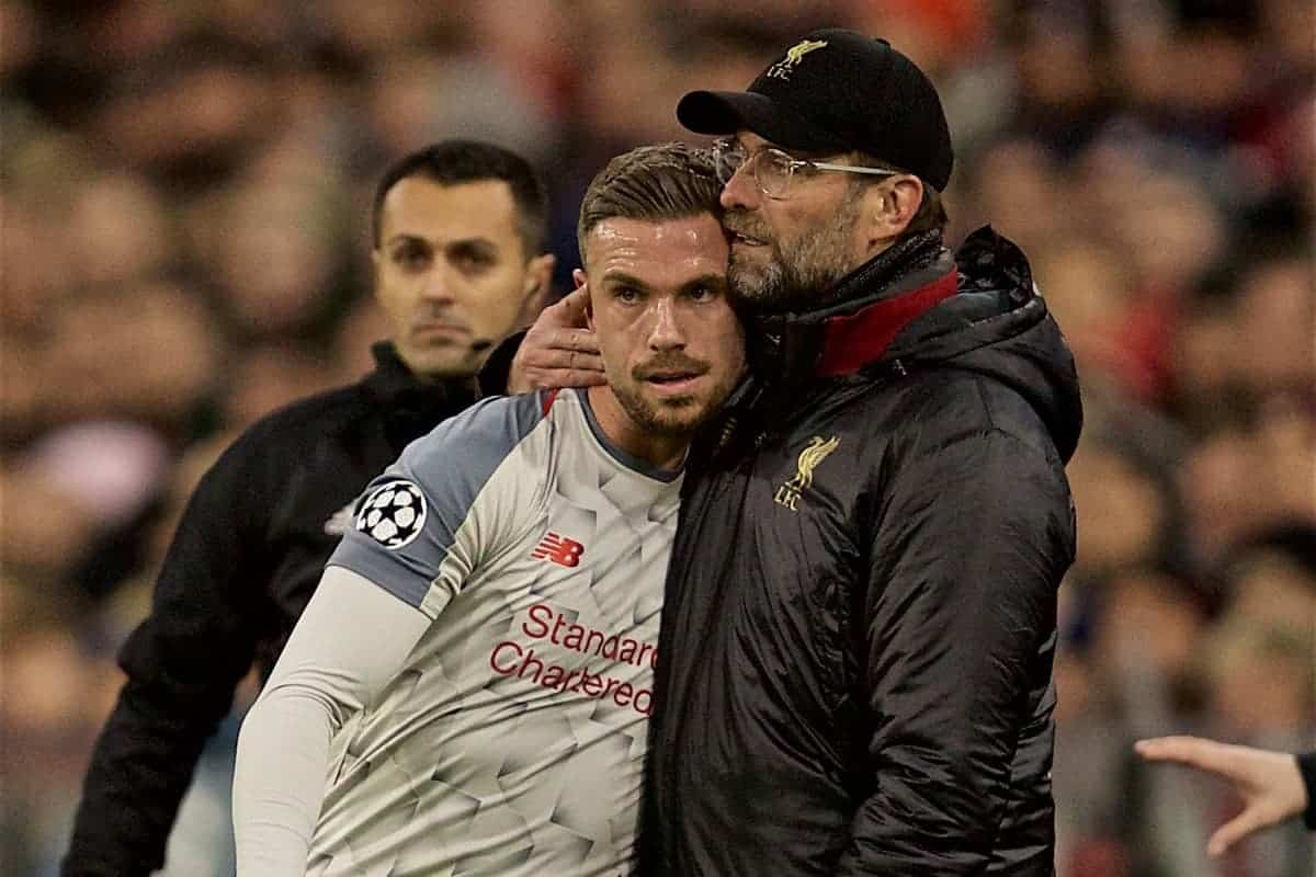 MUNICH, GERMANY - Wednesday, March 13, 2019: Liverpool's manager J¸rgen Klopp embraces captain Jordan Henderson as he is substituted with an injury during the UEFA Champions League Round of 16 2nd Leg match between FC Bayern M¸nchen and Liverpool FC at the Allianz Arena. (Pic by David Rawcliffe/Propaganda)
