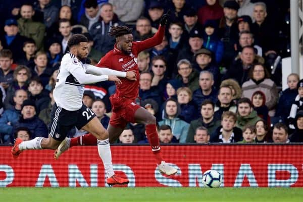 LONDON, ENGLAND - Sunday, March 17, 2019: Fulham's Cyrus Christie (L) and Liverpool's Divock Origi during the FA Premier League match between Fulham FC and Liverpool FC at Craven Cottage. (Pic by David Rawcliffe/Propaganda)