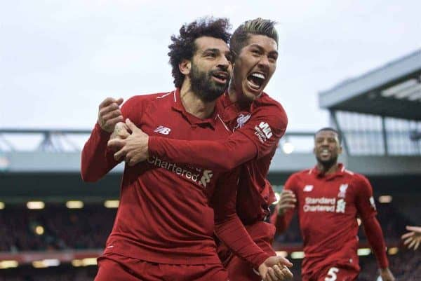 LIVERPOOL, ENGLAND - Sunday, March 31, 2019: Liverpool's Mohamed Salah celebrates after his header forced a winning goal, an own goal from Tottenham Hotspur's Toby Alderweireld with team-mate Roberto Firmino during the FA Premier League match between Liverpool FC and Tottenham Hotspur FC at Anfield. (Pic by David Rawcliffe/Propaganda)