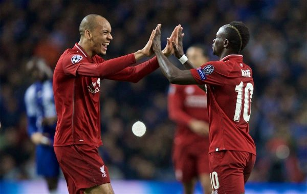 "Liverpool's Sadio Mane (R) celebrates scoring the first goal with team-mate Fabio Henrique Tavares 'Fabinho' during the UEFA Champions League Quarter-Final 2nd Leg match between FC Porto and Liverpool FC at Est·dio do Drag""o. (Pic by David Rawcliffe/Propaganda)"