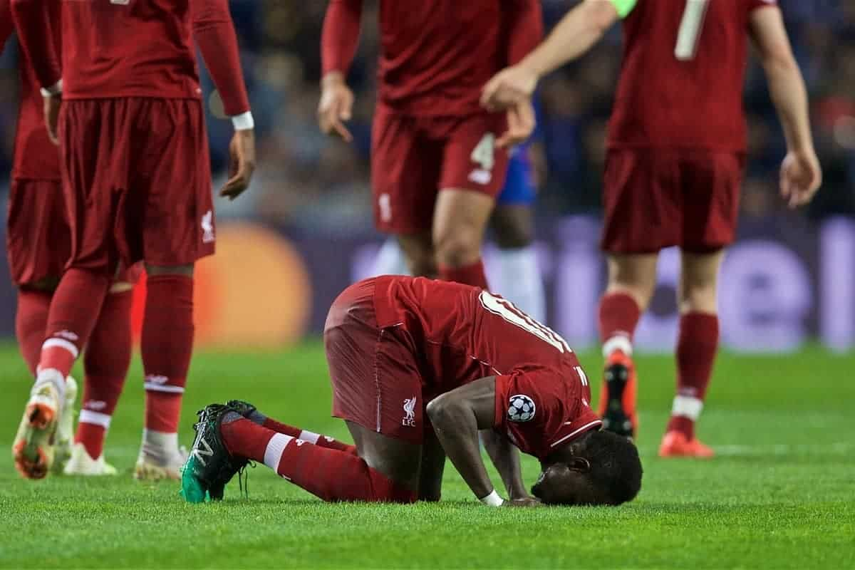 "PORTO, PORTUGAL - Wednesday, April 17, 2019: Liverpool's Sadio Mane kneels to pray as he celebrates scoring the first goal during the UEFA Champions League Quarter-Final 2nd Leg match between FC Porto and Liverpool FC at Est·dio do Drag""o. (Pic by David Rawcliffe/Propaganda)"