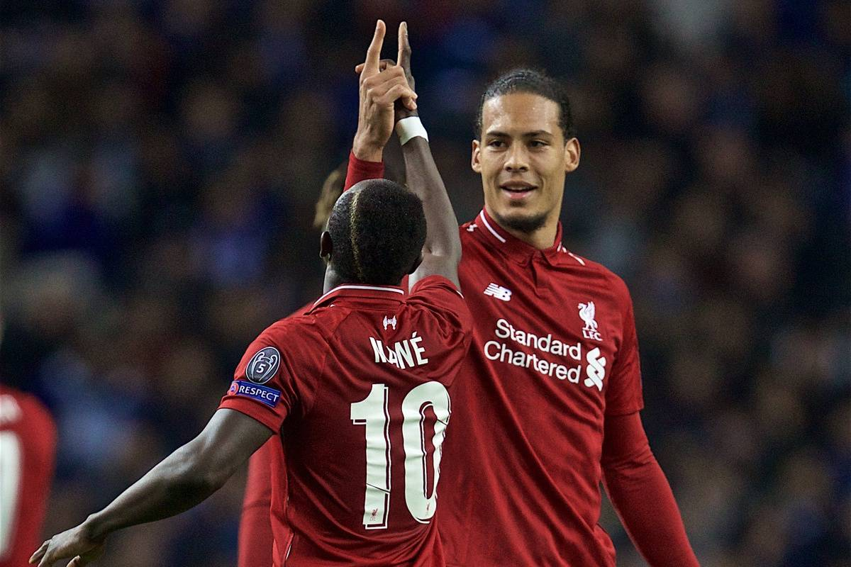 """PORTO, PORTUGAL - Wednesday, April 17, 2019: Liverpool's Sadio Mane celebrates scoring the first goal with team-mated Virgil van Dijk uring the UEFA Champions League Quarter-Final 2nd Leg match between FC Porto and Liverpool FC at Est·dio do Drag""""o. (Pic by David Rawcliffe/Propaganda)"""