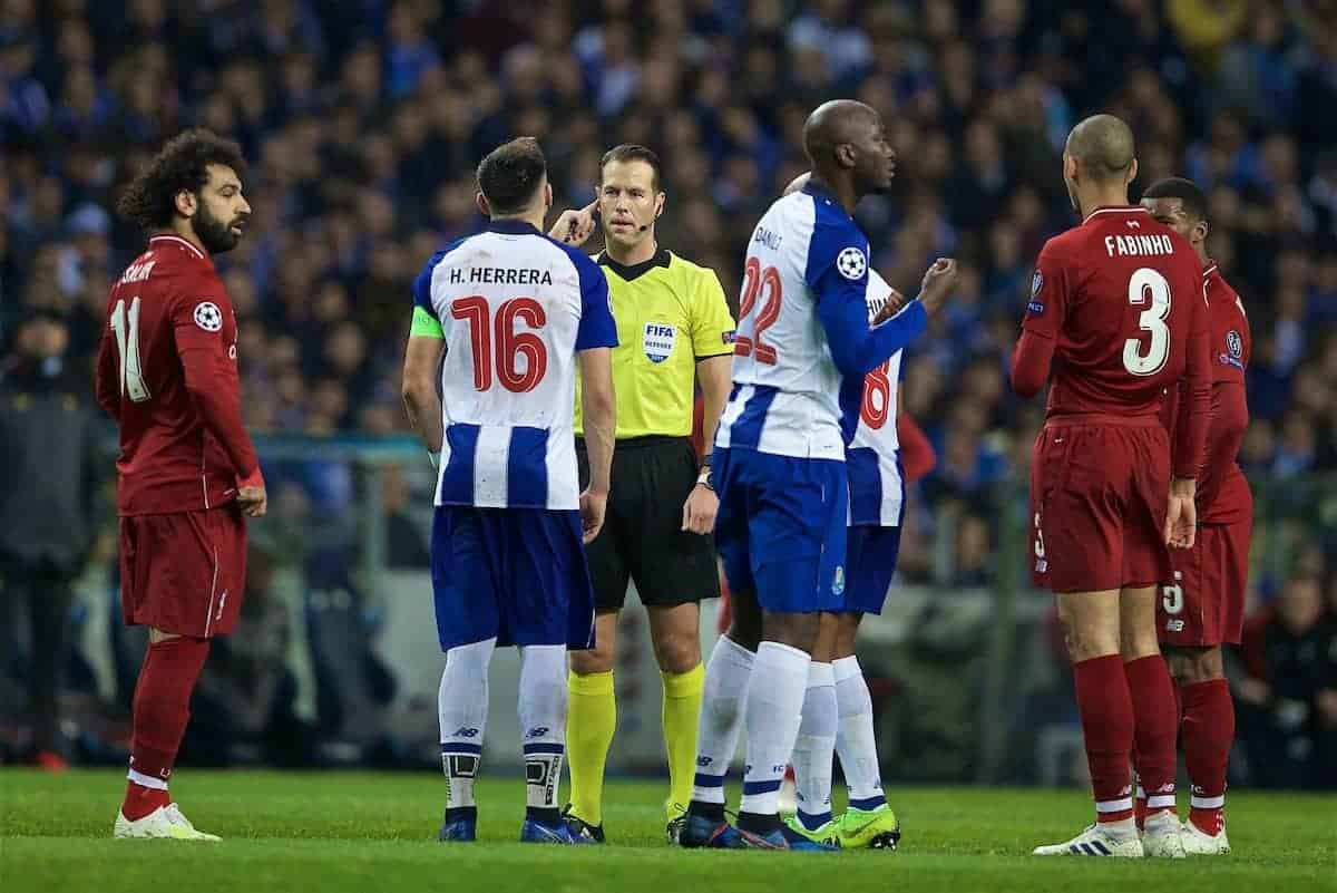 """Referee Danny Makkelie consults VAR during the UEFA Champions League Quarter-Final 2nd Leg match between FC Porto and Liverpool FC at Est·dio do Drag""""o. (Pic by David Rawcliffe/Propaganda)"""