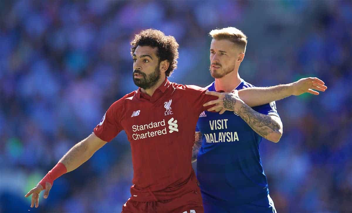 CARDIFF, WALES - Saturday, April 20, 2019: Liverpool's Mohamed Salah (L) and Cardiff City's Joe Bennett during the FA Premier League match between Cardiff City FC and Liverpool FC at the Cardiff City Stadium. (Pic by David Rawcliffe/Propaganda)