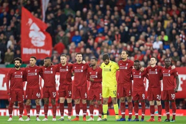 LIVERPOOL, ENGLAND - Friday, April 26, 2019: Liverpool players stand for a minute's silence to remember the late Tommy Smith, the club's first European Cup winning captain, before during the FA Premier League match between Liverpool FC and Huddersfield Town AFC at Anfield. (Pic by David Rawcliffe/Propaganda)