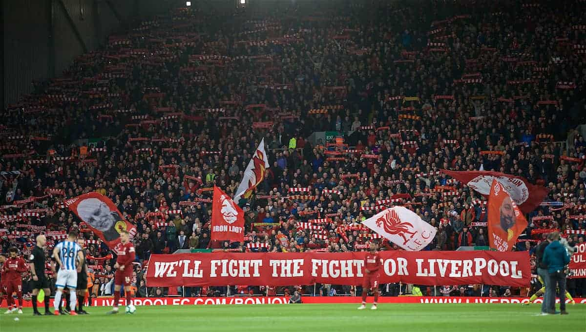"LIVERPOOL, ENGLAND - Friday, April 26, 2019: Liverpool supporters on the Spion Kop unfurl a new banner ""We'll Fight The Fight For Liverpool"" before the FA Premier League match between Liverpool FC and Huddersfield Town AFC at Anfield. (Pic by David Rawcliffe/Propaganda)"