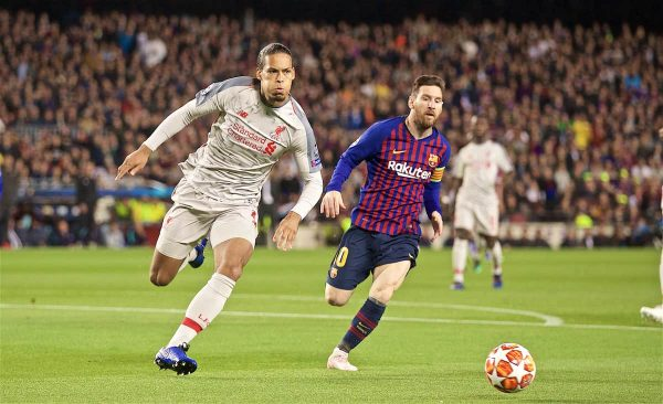 Liverpool's Virgil van Dijk (L) and FC Barcelona's Lionel Messi during the UEFA Champions League Semi-Final 1st Leg match between FC Barcelona and Liverpool FC at the Camp Nou. (Pic by David Rawcliffe/Propaganda)