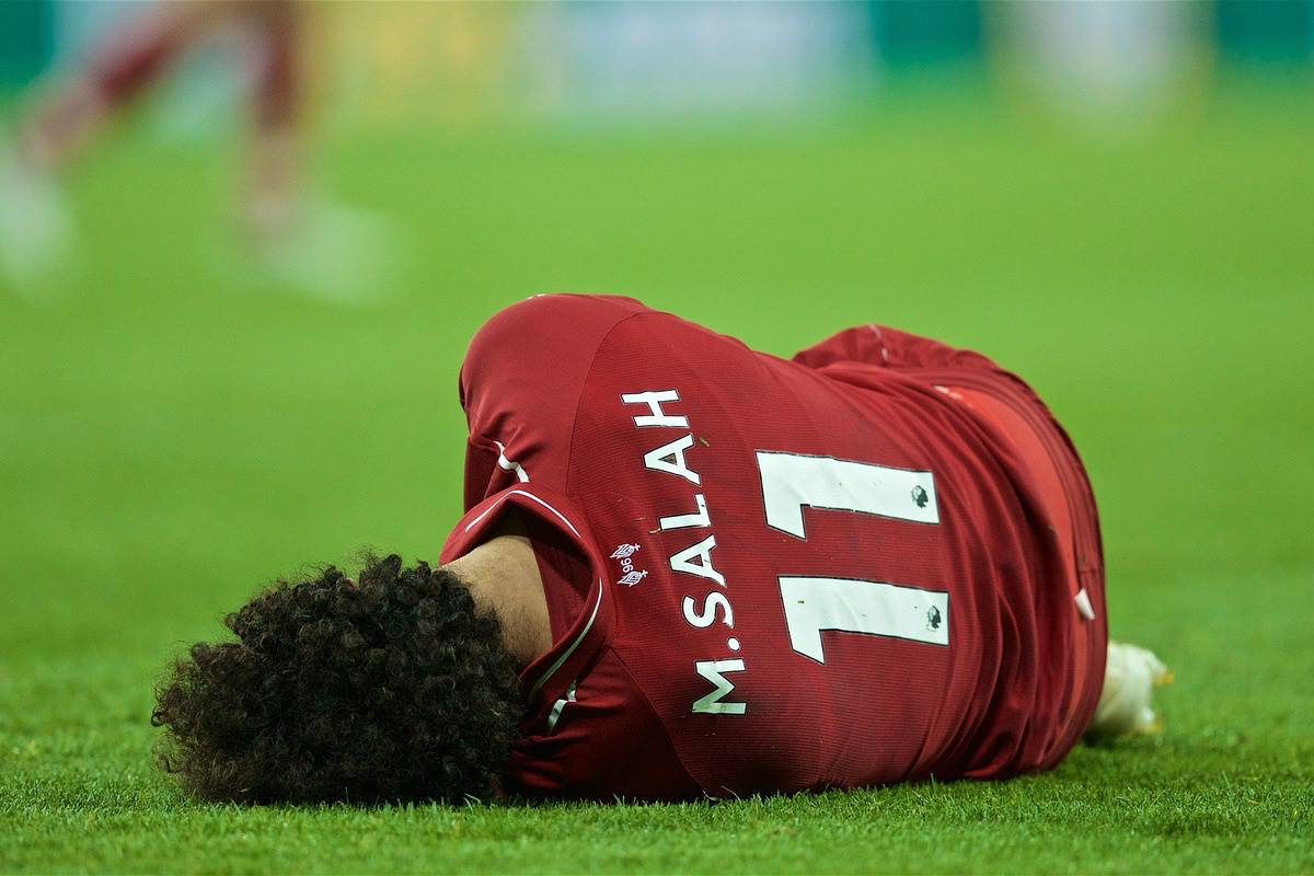 NEWCASTLE-UPON-TYNE, ENGLAND - Saturday, May 4, 2019: Liverpool's Mohamed Salah lies down injured during the FA Premier League match between Newcastle United FC and Liverpool FC at St. James' Park. (Pic by David Rawcliffe/Propaganda)