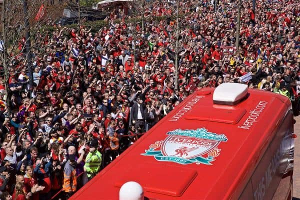 Liverpool supporters take photos of team bus arrive with their smart phones before the final FA Premier League match of the season between Liverpool FC and Wolverhampton Wanderers FC at Anfield. (Pic by David Rawcliffe/Propaganda)