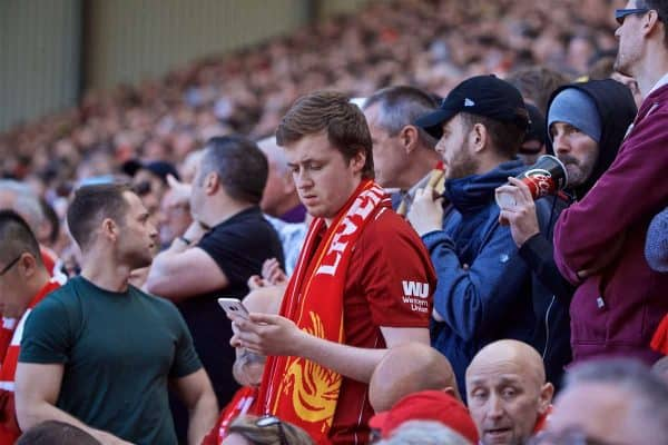 LIVERPOOL, ENGLAND - Sunday, May 12, 2019: Liverpool supporters check the score of the Brighton & Hove Albion versus Manchester City match on their smart phones during the final FA Premier League match of the season between Liverpool FC and Wolverhampton Wanderers FC at Anfield. (Pic by David Rawcliffe/Propaganda)
