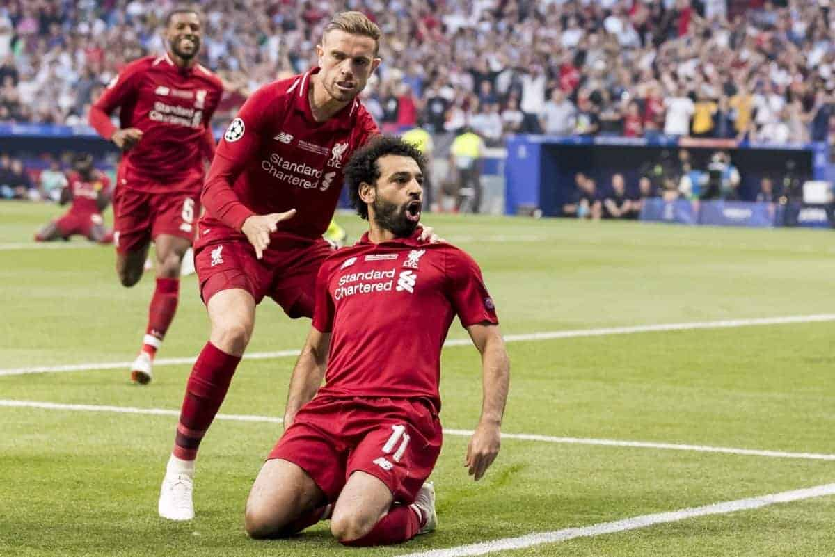 MADRID, SPAIN - SATURDAY, JUNE 1, 2019: Liverpool's Mohamed Salah celebrates scoring his sides first goal from the penalty spot to make the score 0-1 during the UEFA Champions League Final match between Tottenham Hotspur FC and Liverpool FC at the Estadio Metropolitano. (Pic by Paul Greenwood/Propaganda) Jordan Henderson