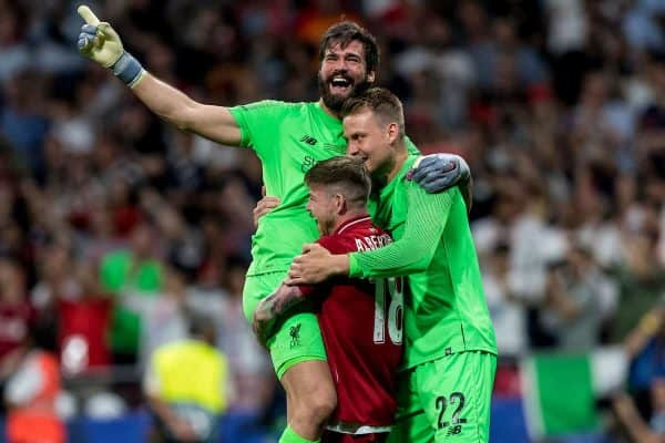 MADRID, SPAIN - SATURDAY, JUNE 1, 2019: Liverpool's goalkeeper Alisson Becker is embraced by Alberto Moreno and Simon Mignolet after a 2-0 victory in the UEFA Champions League Final match between Tottenham Hotspur FC and Liverpool FC at the Estadio Metropolitano. (Pic by Paul Greenwood/Propaganda)