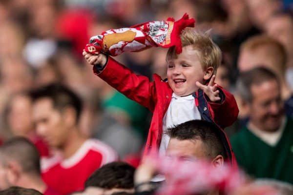 BLACKBURN, ENGLAND - Thursday, July 19, 2018: A young Liverpool supporter waves his scarf as he celebrates the second goal during a preseason friendly match between Blackburn Rovers FC and Liverpool FC at Ewood Park. (Pic by Paul Greenwood/Propaganda)
