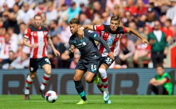 LIVERPOOL, ENGLAND - Saturday, August 17, 2019: Liverpool's Alex Oxlade-Chamberlain (L) and Southampton's Jan Bednarek (R) during the FA Premier League match between Southampton FC and Liverpool FC at St. Mary's Stadium. (Pic by David Rawcliffe/Propaganda)