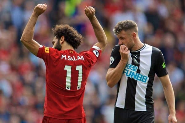 LIVERPOOL, ENGLAND - Saturday, September 14, 2019: Liverpool's Mohamed Salah (L) celebrates scoring the third goal as Newcastle United's Paul Dummett looks dejected during the FA Premier League match between Liverpool FC and Newcastle United FC at Anfield. (Pic by David Rawcliffe/Propaganda)
