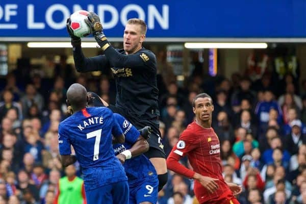 LONDON, ENGLAND - Sunday, September 22, 2019: Liverpool's goalkeeper Adrián San Miguel del Castillo catches the ball and collides with Chelsea's Tammy Abraham during the FA Premier League match between Chelsea's FC and Liverpool FC at Stamford Bridge. (Pic by David Rawcliffe/Propaganda)