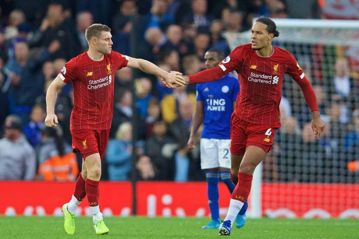 LIVERPOOL, ENGLAND - Saturday, October 5, 2019: Liverpool's James Milner (L) celebrates with team-mate Virgil van Dijk after scoring the winning second goal, an injury time penalty, during the FA Premier League match between Liverpool FC and Leicester City FC at Anfield. Liverpool won 2-1. (Pic by David Rawcliffe/Propaganda)