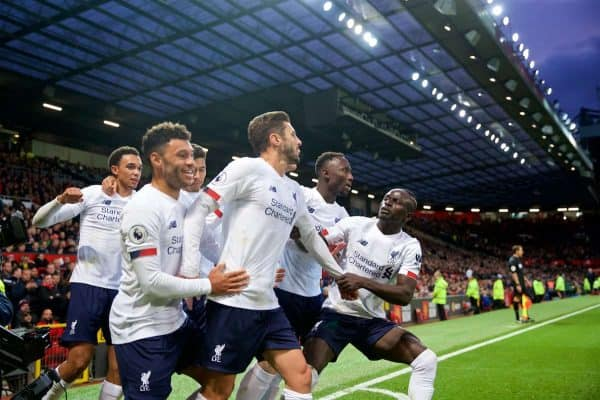 MANCHESTER, ENGLAND - Saturday, October 19, 2019: Liverpool's Adam Lallana (C) celebrates with team-mates after scoring the an equalising goal to level the score at 1-1 and help his side to continue their unbeaten start to the season during the FA Premier League match between Manchester United FC and Liverpool FC at Old Trafford. The game ended in a 1-1 draw. (Pic by David Rawcliffe/Propaganda)