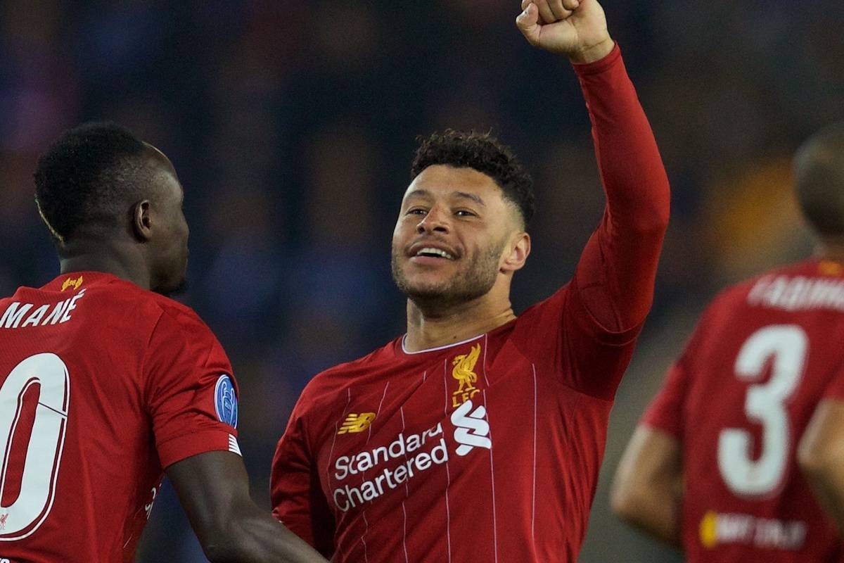 Liverpool's Alex Oxlade-Chamberlain (L) celebrates scoring the first goal during the UEFA Champions League Group E match between KRC Genk and Liverpool FC at the KRC Genk Arena. (Pic by David Rawcliffe/Propaganda)