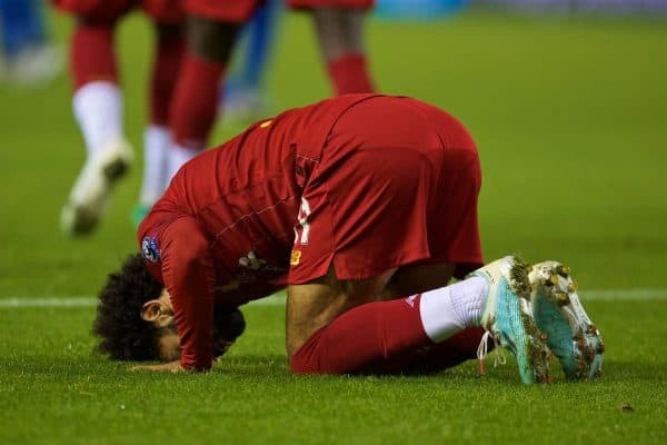 GENK, BELGIUM - Wednesday, October 23, 2019: Liverpool's Mohamed Salah kneels to pray as he celebrates scoring the fourth goal during the UEFA Champions League Group E match between KRC Genk and Liverpool FC at the KRC Genk Arena. (Pic by David Rawcliffe/Propaganda)