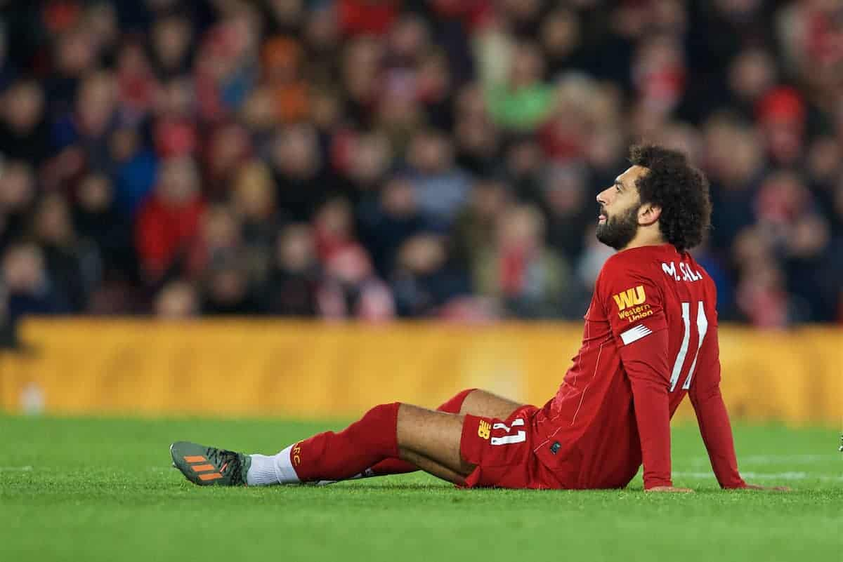 LIVERPOOL, ENGLAND - Sunday, October 27, 2019: Liverpool's Mohamed Salah goes down injured during the FA Premier League match between Liverpool FC and Tottenham Hotspur FC at Anfield. (Pic by David Rawcliffe/Propaganda)