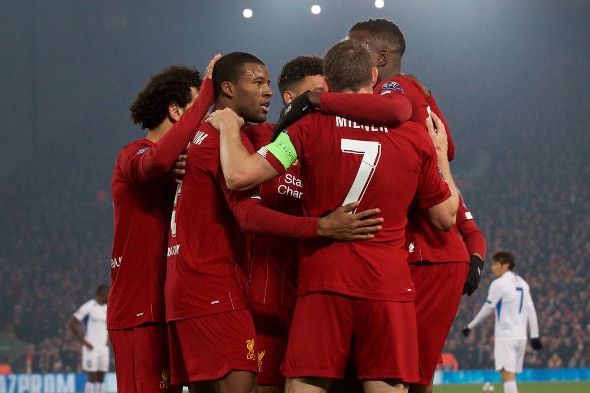 Liverpool's captain Jordan Henderson (2nd from L) celebrates scoring the first goal with team-mates during the UEFA Champions League Group E match between Liverpool FC and KRC Genk at Anfield. (Pic by Laura Malkin/Propaganda)