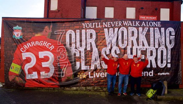 """LIVERPOOL, ENGLAND - Sunday, November 10, 2019: Liverpool supporters from Bergen in Norway unfurl a banner dedicated to Liverpool's """"Working Class Hero"""" Jamie Carragher before the FA Premier League match between Liverpool FC and Manchester City FC at Anfield. (Pic by David Rawcliffe/Propaganda)"""