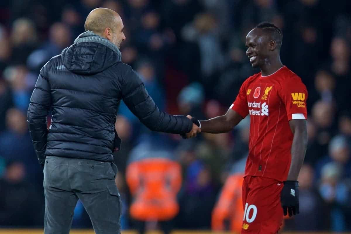 LIVERPOOL, ENGLAND - Sunday, November 10, 2019: Liverpool's Sadio Mané is all smiles as he shakes hands with Manchester City's head coach Pep Guardiola, who had accused him of being a diver, after the FA Premier League match between Liverpool FC and Manchester City FC at Anfield. Liverpool won 3-1. (Pic by David Rawcliffe/Propaganda)