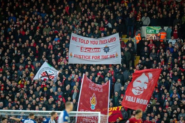 "LIVERPOOL, ENGLAND - Saturday, November 30, 2019: Liverpool supporters on the Spion Kop display a banner ""We Told You They Lied - Justice for the 96"" remembering the 96 victims of the Hillsborough Disaster as the lies told by the Sun newspaper, before the FA Premier League match between Liverpool FC and Brighton & Hove Albion FC at Anfield. (Pic by David Rawcliffe/Propaganda)"