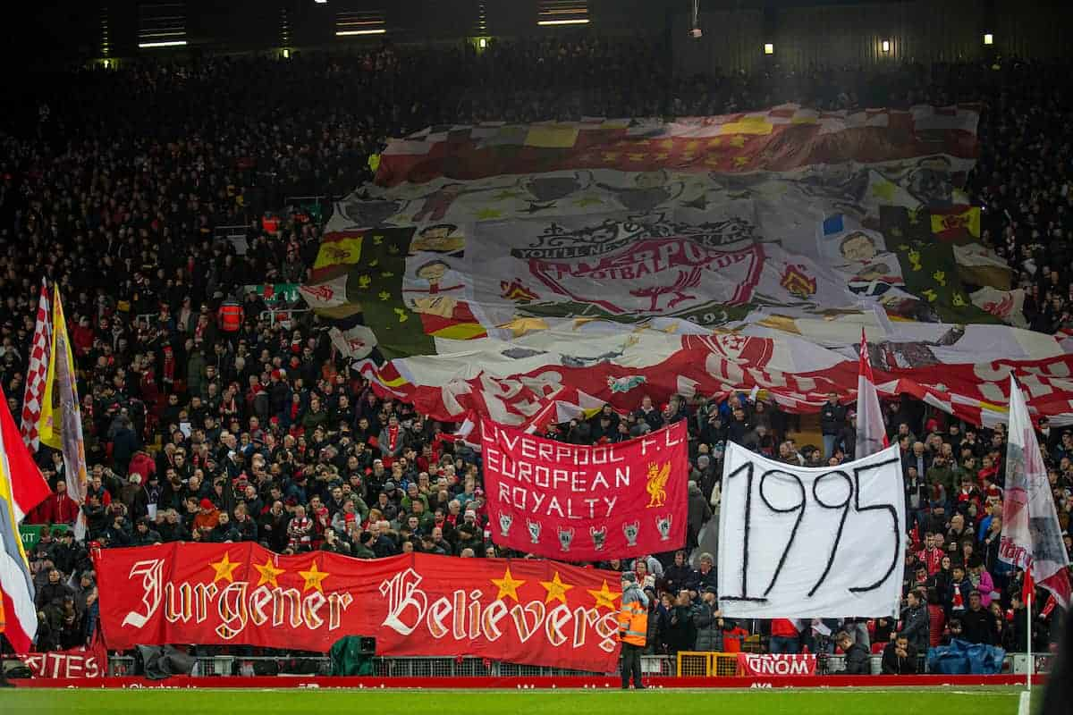 "LIVERPOOL, ENGLAND - Wednesday, December 4, 2019: Liverpool supporters on the Spion Kop with a banner ""1995"", the year Everton last won a trophy, during the FA Premier League match between Liverpool FC and Everton FC, the 234th Merseyside Derby, at Anfield. (Pic by David Rawcliffe/Propaganda)"