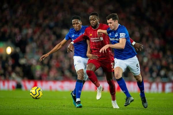 Liverpool's Divock Origi (C) is sandwiched between Everton's Yerry Mina (L) and Michael Keane (R) during the FA Premier League match between Liverpool FC and Everton FC, the 234th Merseyside Derby, at Anfield. (Pic by David Rawcliffe/Propaganda)