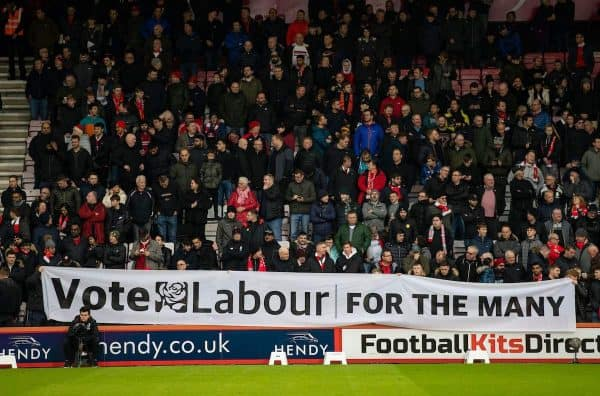 """BOURNEMOUTH, ENGLAND - Saturday, December 7, 2019: Liverpool supporters unfurl a banner """"Vote Labour for the many"""" before the FA Premier League match between AFC Bournemouth and Liverpool FC at the Vitality Stadium. (Pic by David Rawcliffe/Propaganda)"""