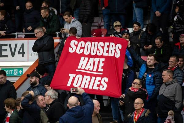 """BOURNEMOUTH, ENGLAND - Saturday, December 7, 2019: Liverpool supporters unfurl a banner """"Scousers Hate Tories"""" before the FA Premier League match between AFC Bournemouth and Liverpool FC at the Vitality Stadium. (Pic by David Rawcliffe/Propaganda)"""