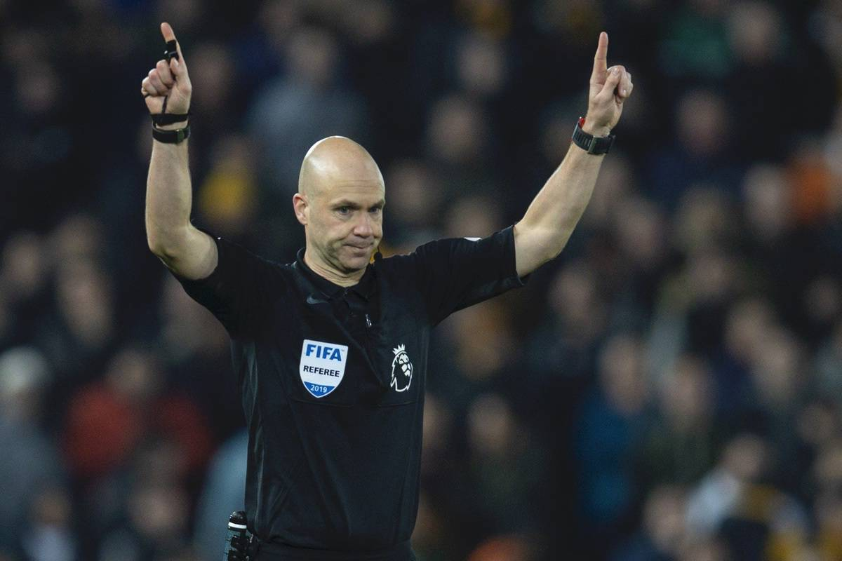 LIVERPOOL, ENGLAND - Sunday, December 29, 2019: Referee Anthony Taylor awards the opening goal to Liverpool after a VAR review during the FA Premier League match between Liverpool FC and Wolverhampton Wanderers FC at Anfield. (Pic by Richard Roberts/Propaganda)