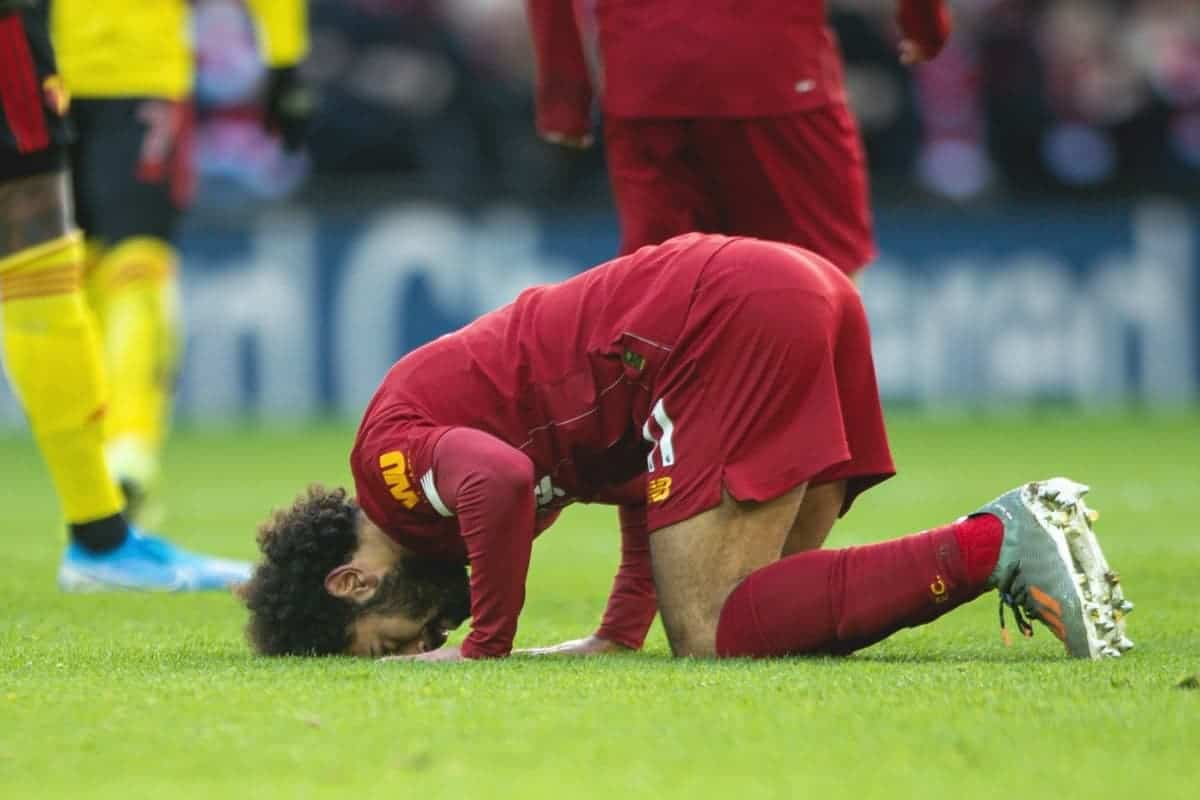 LIVERPOOL, ENGLAND - Saturday, December 14, 2019: Liverpool's Mohamed Salah kneels to pray as he celebrates scoring the first goal the FA Premier League match between Liverpool FC and Watford FC at Anfield. (Pic by Richard Roberts/Propaganda)